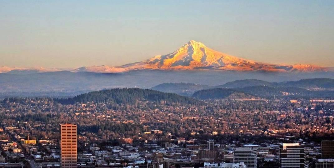 Mt. Hood with sun shining on top.